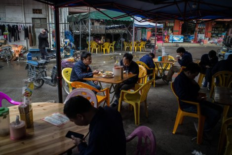 Workers having lunch at a restaurant near a factory for Angang Lianzhong in Guangzhou, China, last month. Credit Lam Yik Fei for The New York Times